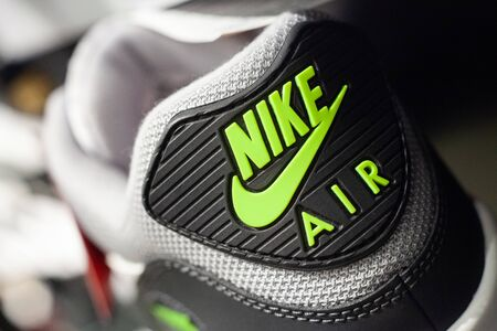 MINSK, BELARUS - December 13, 2019: Nike logo on sneakers in a company store. Nike is one of the world's largest suppliers of athletic shoes and apparel.