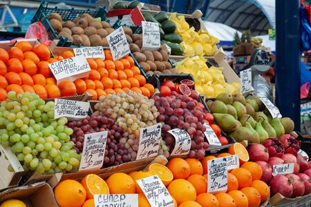 Fruit market with various colorful fresh fruits and vegetables. Healthy food concept. Vitamins and minerals.