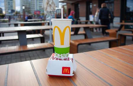 Minsk, Belarus, April 24, 2019: Big Mac and soft drink cup on table in McDonald's restaurant.