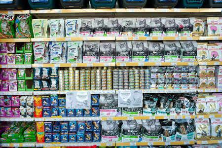 MINSK, BELARUS - June 11, 2020: Food department for pets. Shelving with various types of food for pets inside a supermarket.