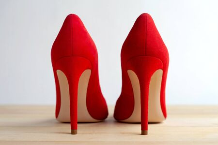 Red female shoes on a wooden floor. Back view 版權商用圖片