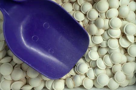 Plastic scoop loads frozen dumplings sold by weight