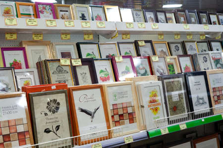Large selection of photo frames in the store. Minsk, Belarus - March 20, 2020