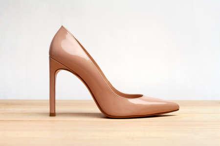 Fashion high heels women shoes beige color. Stiletto shoe style in ladies wardrobe. High fashion and formal female accessory. 版權商用圖片