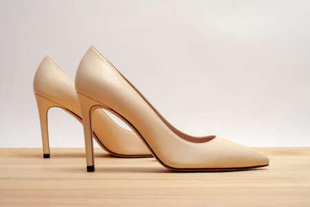 Fashion high heels women shoes beige color. Stiletto shoe style in ladies wardrobe. High fashion.