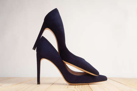 Closeup of blue high heels on white background