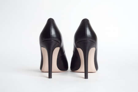 High heels back view. Black high heels on white background
