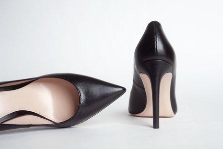 Black shoes. Black high heels on white background 版權商用圖片