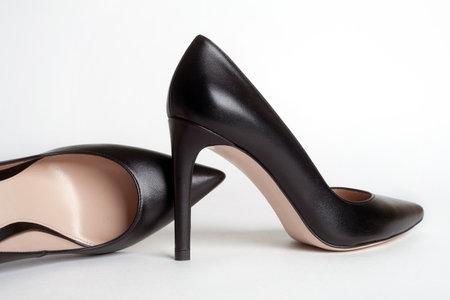 Black high heels on white background