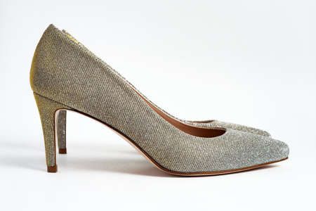 Women silver glitter stylish heel shoes on white background. 版權商用圖片
