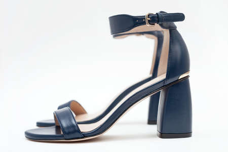 Woman's open toe nude leather heels.