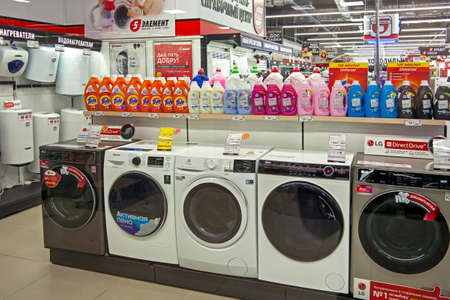 Washing machines, boilers and detergents are sold in a household appliance store. Minsk, Belarus - March 2021