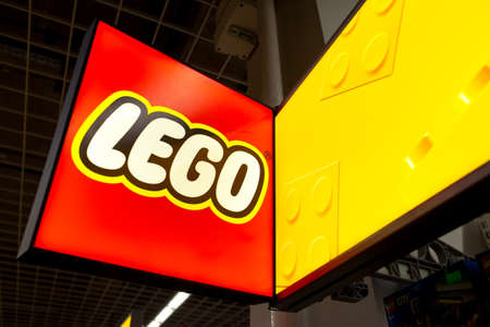 Lego sign in the store. Lego is a line of plastic construction toys that are manufactured by The Lego Group, a privately held company based in Billund, Denmark. Minsk, Belarus - March 2021