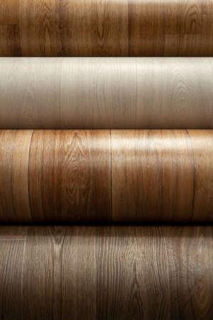 Rolls of linoleum. Closeup of rolls of new linoleum on the window of a hardware store. Zdjęcie Seryjne