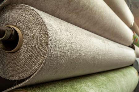 A rolls of carpet for sale in a shop store. Zdjęcie Seryjne