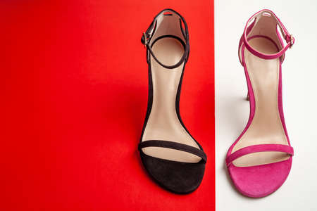 Women's sandals in different colors top view. Copy space text.