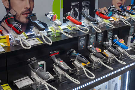 Big choice electric shavers on a shelf in a store. Minsk, Belarus - March 2021