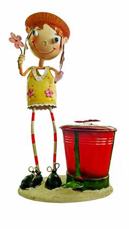 doll sitting in a flowerpot in the garden photo