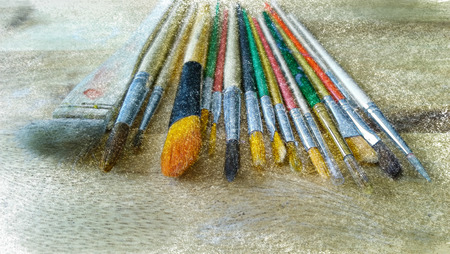 pallette: paint brushes on wood artistic pallette