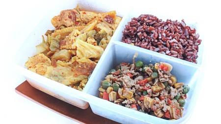 bento: Bento consists of rice, fried basil. Stock Photo