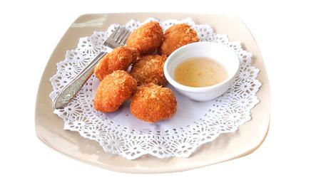 Image of fried shrimp cake on white dish with white background photo
