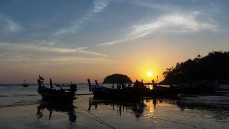 Tropical sunset on  kata noi   beach  Phuket , Thailand photo