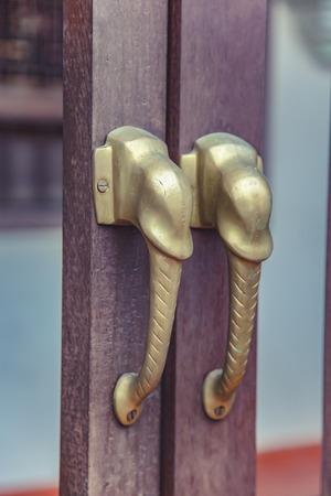 characteristics: Brass Door design characteristics trunk. Stock Photo