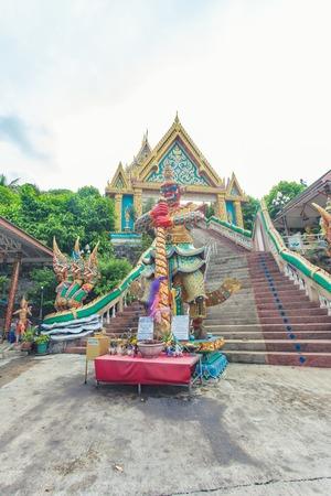 knack: A red giant statue of Wat Kao Rang, Phuket, Thailand