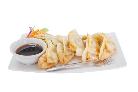 potstickers: Dumplings on a white dish.