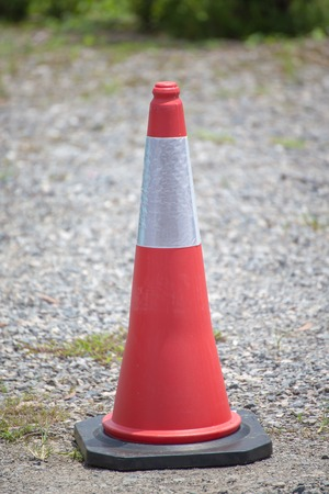 traffic cone: Traffic cone on paved roads