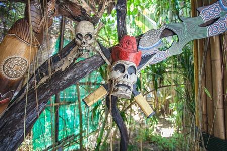 skull mask: Skull mask on garden decor