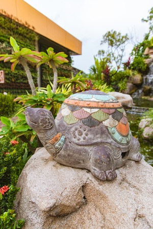 statuary garden: Beautiful sculpture turtle in garden decor Stock Photo