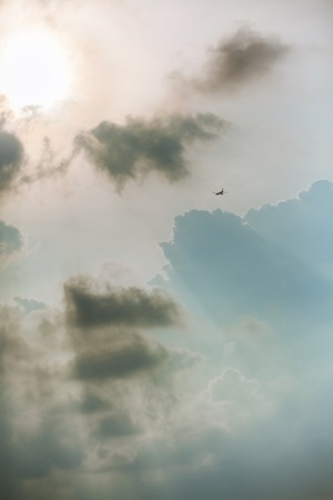 light aircraft: Light aircraft in sunlight with big white clouds,abstract background Stock Photo
