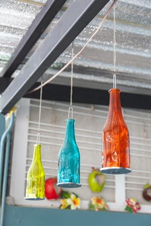 Colorful bottles adapted into a lamp. D.I.Y