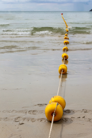 buoys: Line of anchor buoys  the sea and a wave in Patong Beach, Phuket,Thailand Stock Photo
