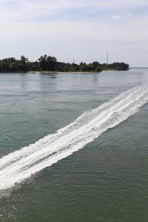 seaway: Water steam at sea after speed boat