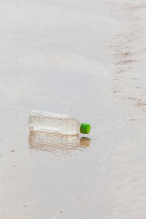 invade: plastic bottle on sea beach Stock Photo
