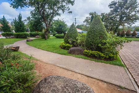 settle back: Beautiful garden flower bed between path