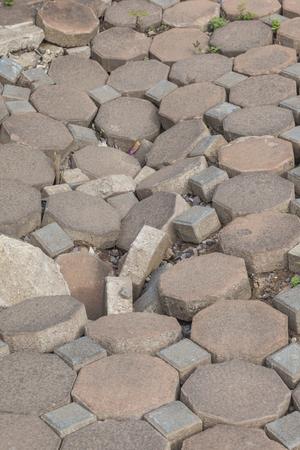 deteriorate: closed up crack gray concrete block pavement walkway has broken Stock Photo