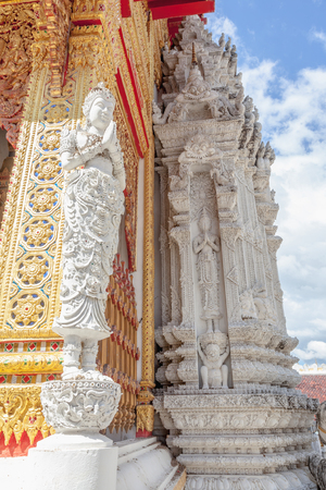 Thailand Angel sculpture on wall at thai temple Stock Photo
