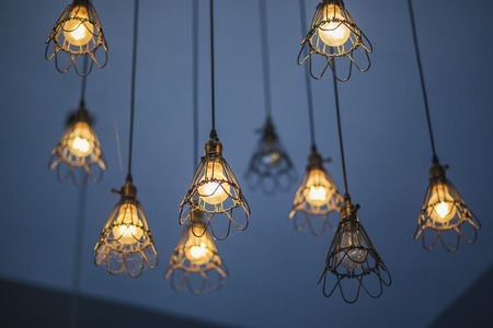 chandelier background: lamp ,light bulb and lamp in modern style in coffee shop Stock Photo
