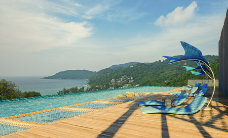 coastal: Sea View Andaman sea Beautiful Swimming pool with armchair and wooden floor  - 3d rendering Stock Photo
