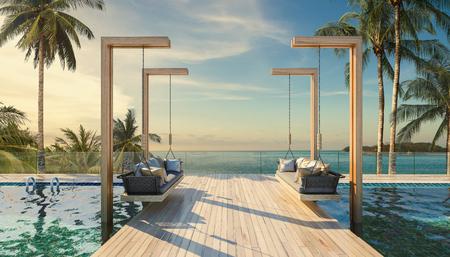 Schönes Schwingensofa auf dem Swimmingpool wässert tropische Küstenlinie im Freien mit blauem Ozeanseehorizont
