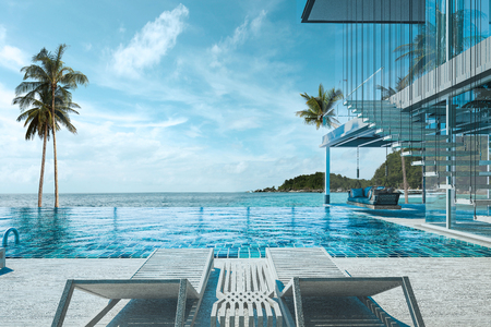 Beautiful view of Swimming Pool with  the sea at sunlight  - 3d rendering Фото со стока