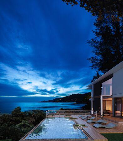 Sea view swimming pool in modern loft design,Luxury ocean Beach house,Night view  3d rendering