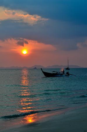 fishingboat: Fishing boat with Sunset at Railay Beach, Krabi, Thailand Stock Photo