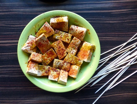marinade: Tofu Marinade in green plate for skewers Stock Photo