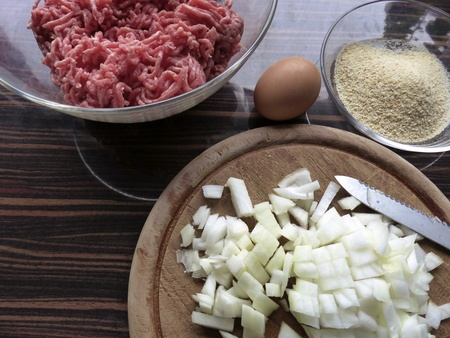 breadcrumbs: Meatballs ingredients, ground beef, egg, breadcrumbs, onion  l Stock Photo