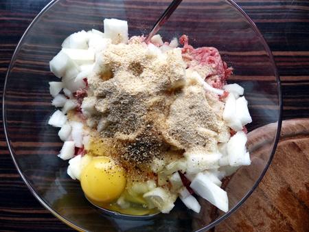 breadcrumbs: Meatballs ingredients, ground beef, egg, breadcrumbs, onion   Stock Photo