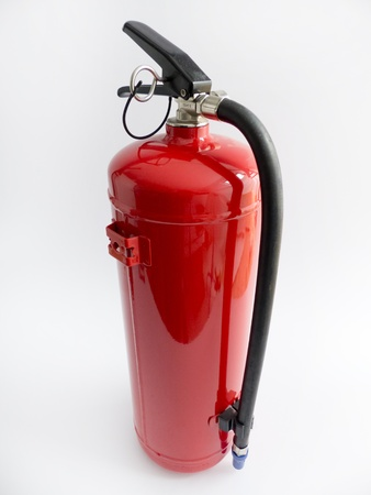 Red exempted fire extinguisher in front of white background